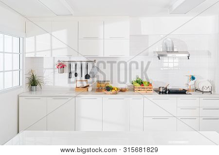 Modern White Kitchen With Counter And White Details, Minimalist Interior, Full Set Of Kitchen Equipm