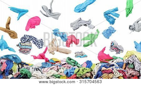 Separate Clothing Falling At The Big Pile Of Clothes On A White Background