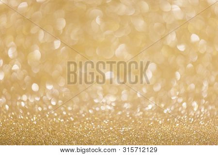 Abstract shining glitters golden holiday bokeh background with copy space for text