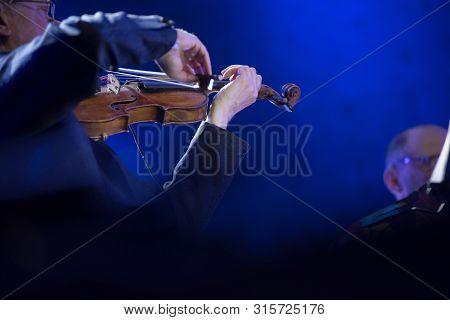 String Quartet Performing A Symphonic Concert