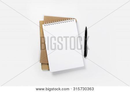 School Notebook On A White Background, Spiral Notepad On A Table. Flatlay