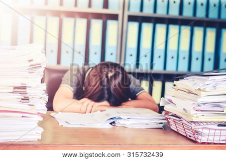 Blurred Business Woman Asleep On Office Desk At Office Desk With F Paperwork Stack Documents And Fin