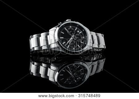 Luxury Wrist Watch. Brand. Japan Watch. Luxury Watch Isolated On A Black Background With Reflection.
