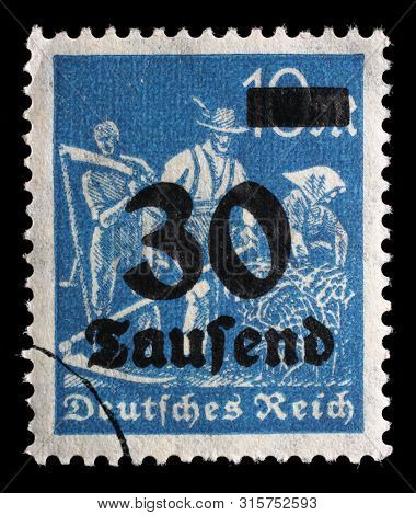 GERMAN REICH - CIRCA 1921: A postage stamp printed in Germany shows Reaper, Definitives series, circa 1921.