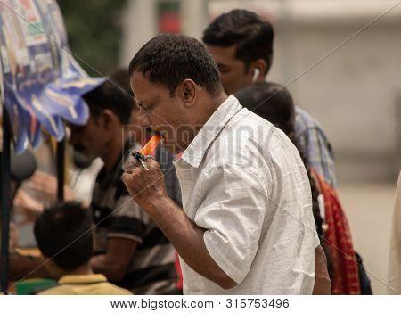 Bangalore, Karnataka India-june 04 2019 : Man Eating Ice Cream On Hot Sunny Day Near Vidhana Soudha