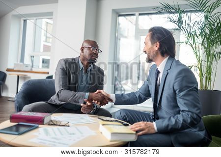 Dark-skinned Businessman Shaking Hand Of His Economist After Consultation