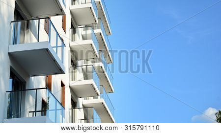 Contemporary Residential Building Exterior In The Daylight. Modern Apartment Buildings On A Sunny Da