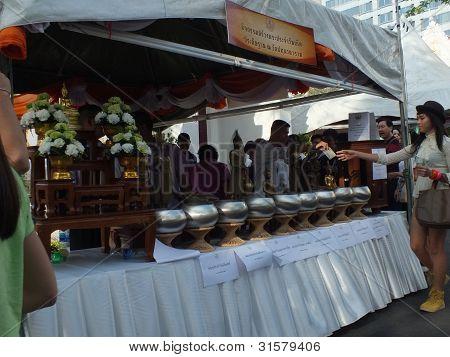 Wat Pathum Wanaram Bangkok - March 7 2012 - donate to build her birthday diurnal Buddha icon.