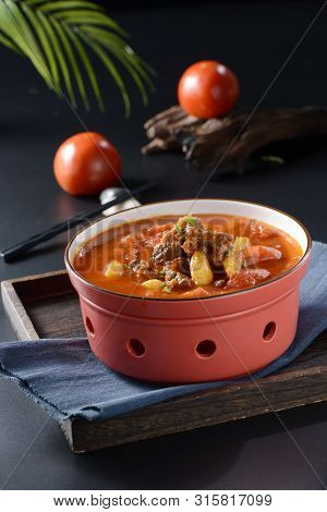 Braised Beef Brisket With Tomato In A Red Clay Pot