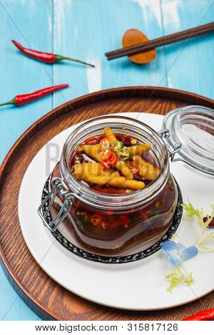 Cold Chicken Feet With Vinegar Pepper In A Transparent Glass Jar
