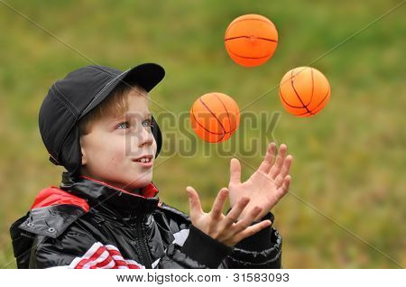 The boy plays with balls