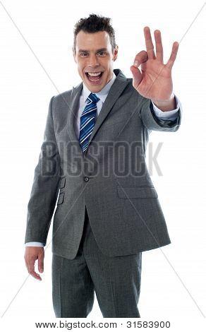Handsome Corporate Man Gesturing Excellent
