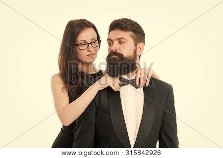 Let Me Help With Bow Tie. Woman Elegant Lady Adjust Male Bow Tie. Man Bearded Gentleman Wear Black T