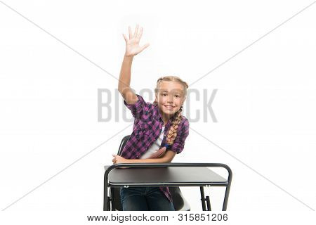She Is A Bright Student. Small Girl Student Raising Hand Isolated On White. Little Student Reciting