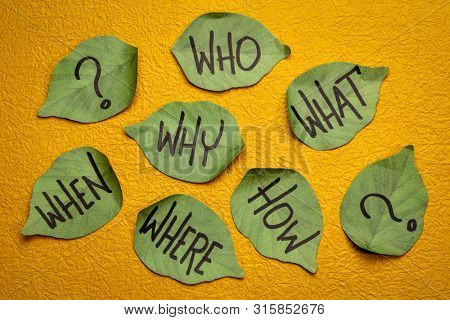 why, who, what, when, where, how brainstorming or decision making questions - handwriting on leaf shaped sticky notes against yellow textured paper