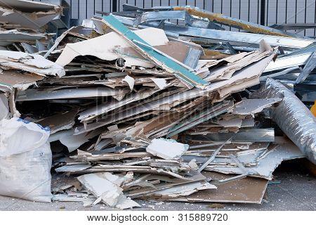 Garbage Heap With Debris On Street. Removal Of Debris. Trash Heap.