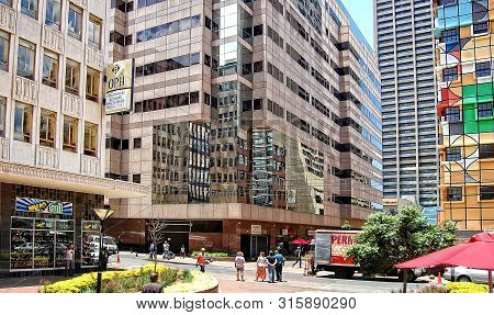 Johannesburg, South Africa - December 21, 2013: The Modern View Of Johannesburg. People Walk In The