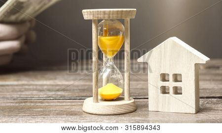 Wooden house and clock. Businessman counting money. Payment of deposit or advance payment for renting a home or apartment. Long-term mortgage on the house. Tax and mortgage vacations. Pledge poster
