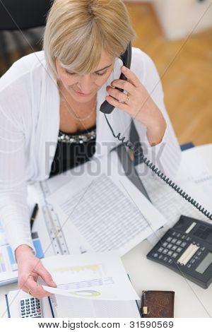 Senior Business Woman Making Phone Call. Top View