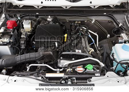 Buckingham, Uk - May 16, 2019. Engine Compartment Underneath The Hood Or Bonnet Of A 2019 Suzuki Jim
