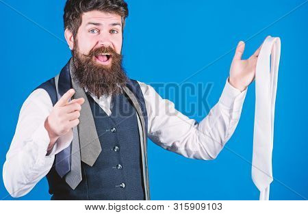 You Should Purchase It. Shop Assistant Pointing Finger And Offering Broad Assortment Of Neckties To
