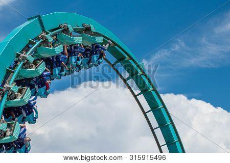 Orlando, Florida. July 31, 2019. People Having Fun Amazing Kraken Rollercoaster At Seaworld 10