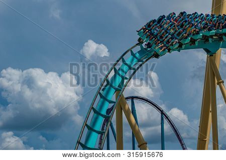 Orlando, Florida. July 31, 2019. People Having Fun Amazing Kraken Rollercoaster At Seaworld 37