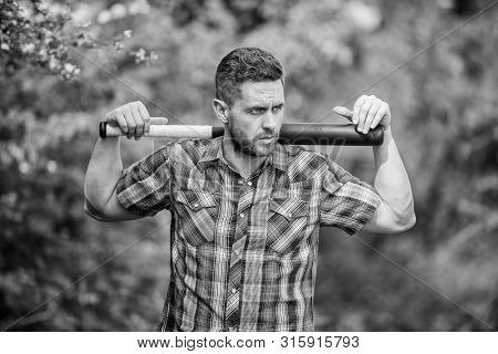 Wild Energy. Power And Strength. Feel My Strength. Man Unshaven Strict Face Hold Black Baseball Bat.