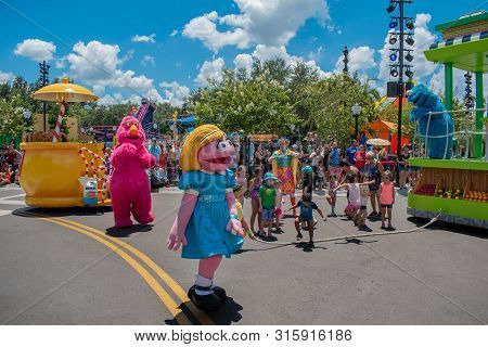 Orlando, Florida. July 30, 2019. Telly Monster, Abby Cadabby, And Dancer Woman Playing With Children