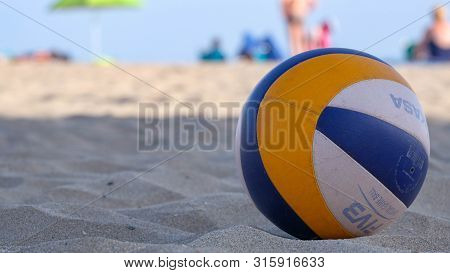 Roses, Girona, Spain- August 1, 2019: Beach Volleyball Ball Mikasa On A Sand. Summer Sport Activity