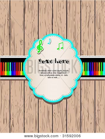 Wooden background with rainbow piano and frame.