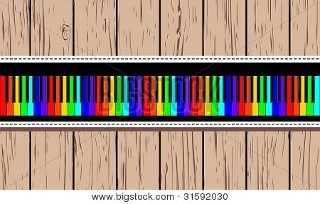 Wooden card with rainbow piano.