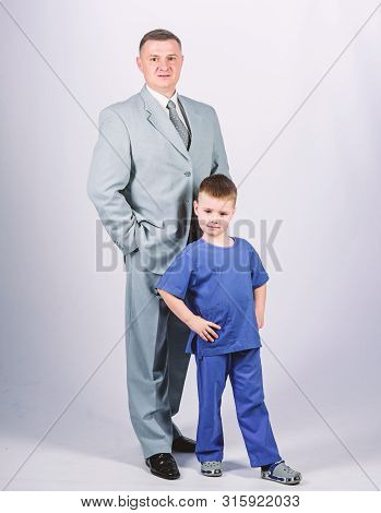 Man Respectable Businessman And Little Kid Doctor Uniform. Doctor Respectable Career. Dad Boss. Fath