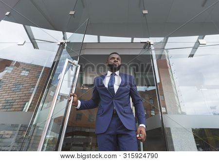 Personal African American Bodyguard Monitoring Environment Before Boss Will Leave The Building. Low-