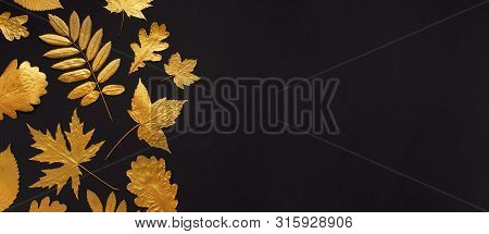 Flat Lay Creative Autumn Composition. Golden Leaves On Black Background Top View Copy Space. Fall Co