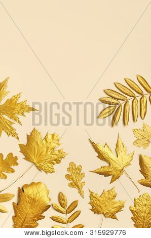 Flat Lay Creative Autumn Composition. Golden Leaves On Beige Background Top View Copy Space. Fall Co