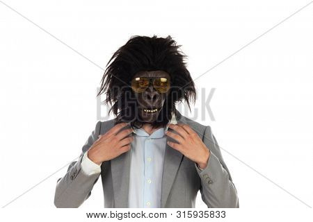 Businessman with gorilla head gesturing isolated on a white background