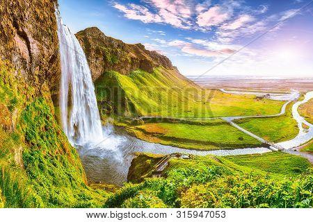 Beautiful  Seljalandsfoss Waterfall In Iceland During The Sunset. Location: Seljalandsfoss Waterfall