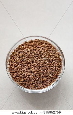 Bowl Of Buckwheat Isolated On White Background. Top View.