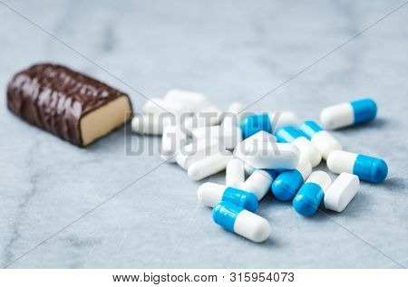 High Protein Bar, Tri-creatine Malate And Arginine Capsules And Bcaa Amino Acids.  Bodybuilding Food