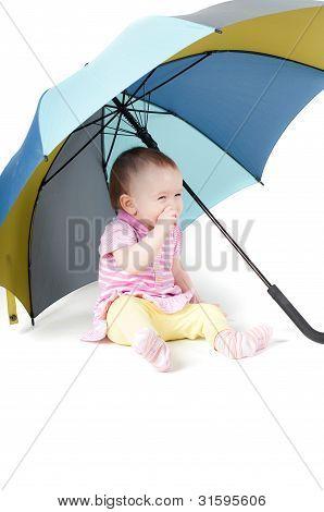 Cute Baby Girl Under Umbrella
