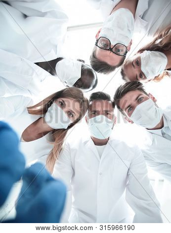 Anesthetists and surgeons working at the operation room poster