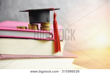 Scholarships Education Concept With Graduation Cap On Coin Money Saving For Grants Education On A Bo