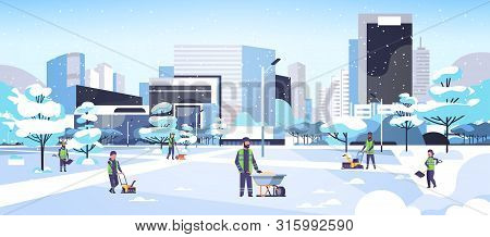Cleaners Team Using Different Equipment And Tools Snow Removal Concept Men Women In Uniform Cleaning