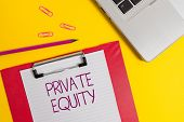 Text sign showing Private Equity. Conceptual photo Capital that is not listed on a public exchange Investments Slim metallic laptop clipboard paper sheet clips pencil colored background. poster