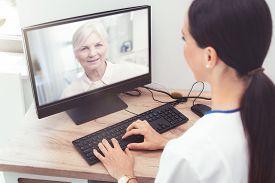 Doctor And Senior Woman Patient Medical Consultation, Telehealth, Telemedicine, Remote Health Care C