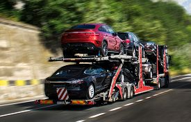 A Car Carrier Trailer, Known Variously As A Car-carrying Trailer, Car Hauler, Auto Transport Trailer