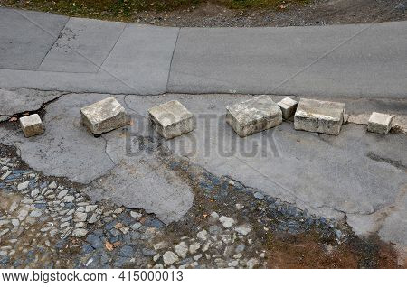 Improvised Barrier To Cars Entering The War Zone Where Irregular And Variously Sized Blocks Of Concr