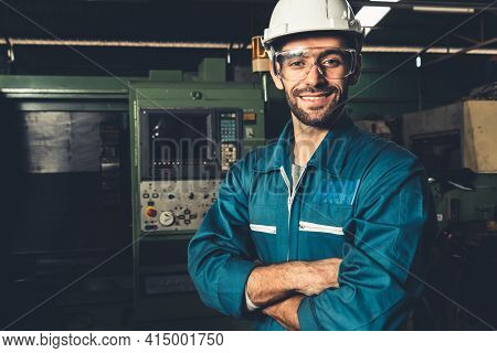 Young Skillful Factory Worker Or Engineer Close Up Portrait In Factory . Industry And Engineering Co