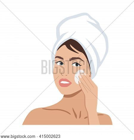 Portrait Of A Beautiful Woman With A Towel On Her Head Cleaning Her Face. Skincare Or Spa Concept
